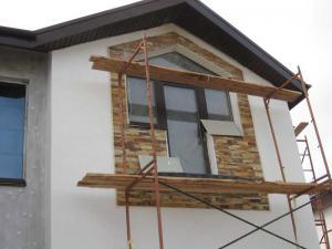 Строительство коттеджей требует качественной отделки фасадов
